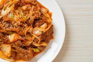 Stir-fried pork with Korean spicy paste and kimchi - Korean food style photo