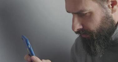 Bearded Man Watching the Phone Screen video