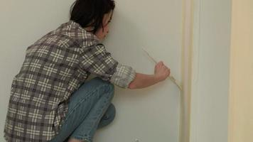 Women Finishes Painting a Wall video