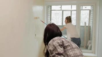 A Pair of People Paints the Wall of an Apartment video
