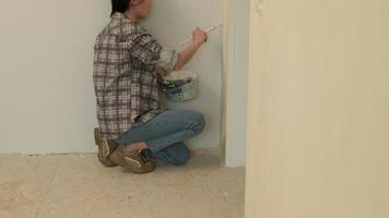 A Woman Trim Painting the Corner of the Wall video