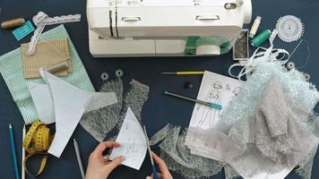 desktop seamstress designer lingerie top view blue background video