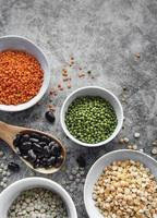 Bowls with different types of legumes photo