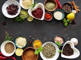 Various spices in a bowls on a black photo