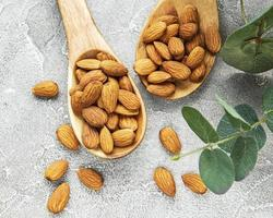 Almonds in brown bowl photo