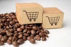 Box with shopping cart logo symbol on coffee beans Import Export Shopping online or eCommerce delivery service store product photo