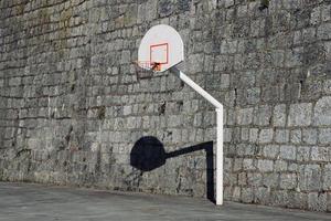 old street basketball hoop photo