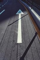 arrow road sign on the street photo
