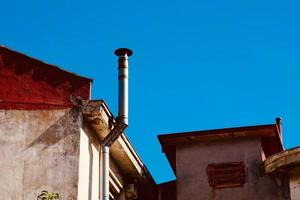 chimney on the rooftop of the house photo