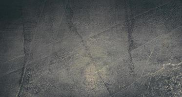 Grunge stone wall with crack for texture background photo