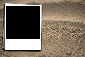 preparation of an instant photo on the background of sea sand