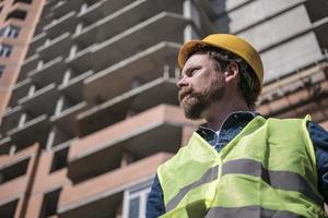 mustache brigadier bearded foreman in a yellow helmet photo