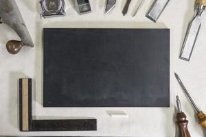 blackboard for chalk on a workbench and carpentry tools photo