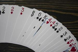 playing cards on the table beautiful wooden background copy space photo