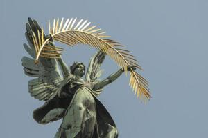 bronze sculpture genius with wings on the roof of the opera house in Lvov photo