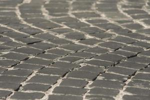Pavimento en el casco antiguo de adoquines negros textura de fondo de papel tapiz foto
