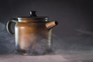 Yixing clay teapot in haze photo
