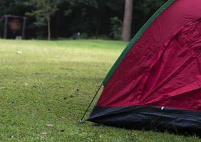 Red camping tent holiday concept photo
