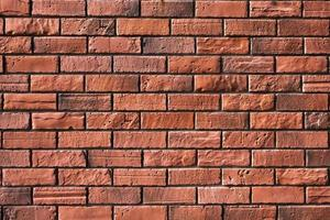 vintage red brick wall background  of red color photo