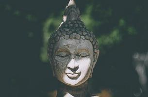 Statue of Buddha standing in meditation photo