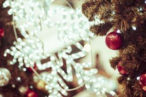 Decorated Christmas tree  blurred background photo