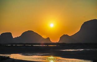 mountain ranges against sunset photo
