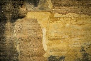 Amarillo viejo muro de hormigón sucio textura o fondo foto