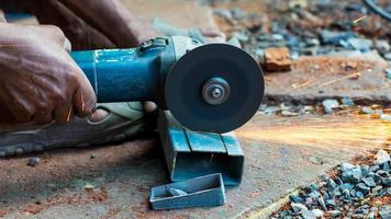 Workers are cutting steel pipes with fiber cutters in industrial work for home construction photo