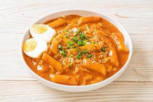Korean instant noodle and Tteokbokki in Korean spicy sauce or Rabokki photo