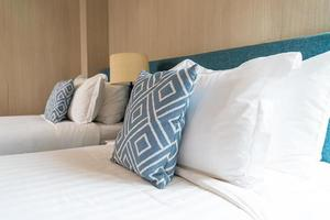 Pillow on bed decoration room interior photo