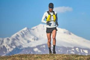 Man travel athlete in the mountains in high altitude photo