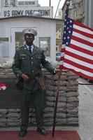 Checkpoint Charlie in Berlin Germany It was the former border crossing between the West and East Berlin during the Cold War photo