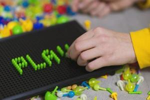 Kid playing pinning board game photo