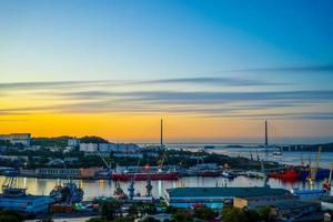 Dawn over the sea Bay overlooking the Russian bridge photo