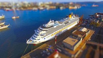 Aerial view of the cityscape with a white cruise liner in the port photo