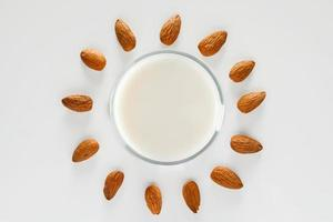A glass of almond milk on a white background photo