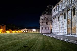 The cathedral and baptistery in Pisa photo