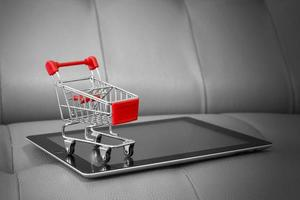 Shopping cart on digital tablet Shopping online concept photo