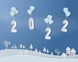 Happy new year 2022 with balloon floating above countryside on paper art background vector