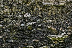 muro de piedra rústica foto