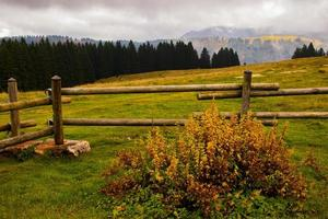 Wooden fence and mountains photo