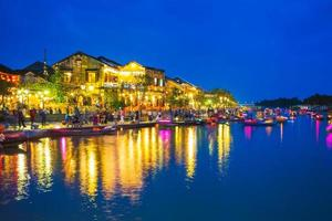 Hoi An ancient town by Thu Bon River in Vietnam at night photo