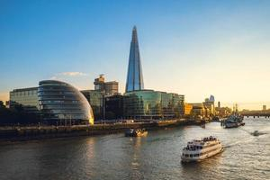 Skyline of London by the Thames river in England photo
