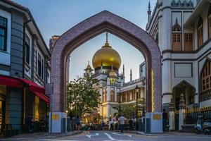 Street and Sultan Masjid at night in Singapore photo