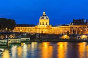 Night scene of National Residence of the Invalids and the Pont des Arts in Paris photo