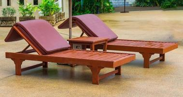 Leisure chairs at  swimming pool photo