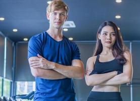 Couple young people smile relax after training in the gym  Healthy exercise concepts photo