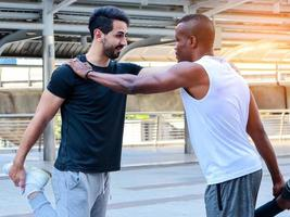 Two handsome men in sportswear are exercising outdoors Exercise concepts for good health photo