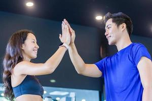 Two young people smile relax after training in the gym photo