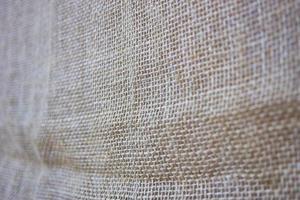 Canvas fabric closeup texture with defocuse background photo
